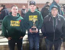 Fort Saskatchewan High School Sting receiver and halfback Ryan Chapman (centre) received the Halliburton Award for the Gilfillian Division MVP. He is flanked by Sting offensive coordinator Steve Stuber (left) and head coach Tyler Hussey. (Supplied)