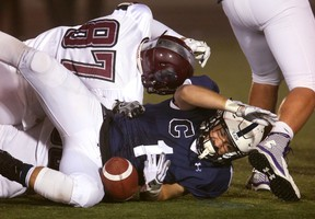 South's Cole Wilkinson tackles Derek Aubin of CCH and the ball comes loose but he was ruled down on the play in the first quarter of their WOSSAA (city final) on Thursday, November 24 in London, Ont. (MIKE HENSEN, The London Free Press)