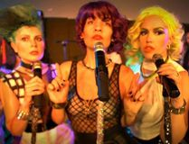 Rebecca Noelle, centre, is flanked by fellow members of The PepTides. The Ottawa nine-piece band is stopping in London to hit the 765 Old East Bar and Grill stage tonight (Friday) at 11 p.m. (Facebook.com/thepeptides)