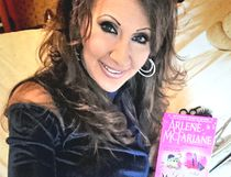 Local author Arlene McFarlane is shown with her first book, Murder, Curlers and Cream. (Supplied photo)