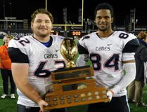Delhi natives Matthew Verbrugge and Johann Jenkins celebrated winning the Ontario Football Conference title with the Hamilton Hurricanes earlier this month. CONTRIBUTED PHOTO