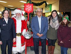 On Saturday, the Salvation Army launched its Christmas Kettle and Angel Tree campaigns at the Pembroke Mall. In the photo for the occasion are, starting from left to right, Lt. Kath Walker, Salvation Army, Santa Jack, Pembroke Mayor Michael LeMay, Bailey Davidson and Kassandra Jurgens. The campaigns help the Salvation Army help others, especially during the holiday season.