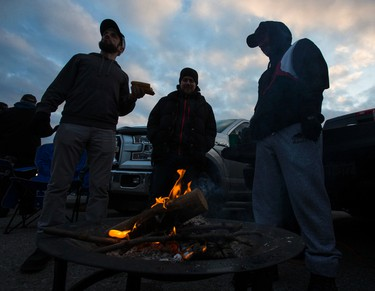 Enjoying a fire at the Grey Cup tailgate party at the parking lot of Ontario Place across the road from BMO Field in Toronto on Nov. 27, 2016. (Ernest Doroszuk/Toronto Sun/Postmedia Network)