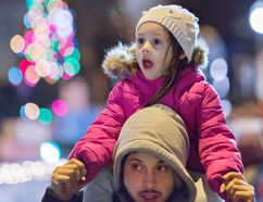 Three-year-old Adrianna Bellissimo sits on her father Vinnie's shoulders to watch floats make their way along Dalhousie Street in Brantford, Ontario on Saturday November 26, 2016 during the 42nd annual JCI Brantford Santa Claus parade. Brian Thompson/Brantford Expositor/Postmedia Network