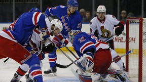 New York Rangers goaltender Antti Raanta prepares to make a save as teammate Marc Staal helps keep Ottawa Senators' Tom Pyatt from the puck during the first period of an NHL hockey game in New York, Sunday, Nov. 27, 2016. (AP Photo/Rich Schultz)