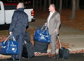 Gerard Gallant, former Florida Panthers head coach, waits for a cab after being relieved of his duties following an NHL game against the Carolina Hurricanes on Nov. 27, 2016 in Raleigh, N.C. (AP Photo/Karl B DeBlaker)