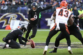 Justin Tucker of the Baltimore Ravens kicks one of his four field goals against the Cincinnati Bengals yesterday in Baltimore. (ROB CARR/Getty Images)
