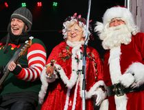 Tim Miller/The Intelligencer Santa and Mrs. Claus dance to music by Dallas Smith and Odds during the CP Holiday Train stop in Belleville on Monday.