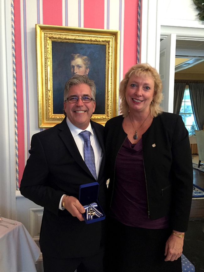 Sarnia's Rick LaBelle, shown standing with Sarnia-Lambton MP Marilyn Gladu at Rideau Hall Friday, holds a Meritorious Service Decoration presented posthumously Friday in honour of LaBelle's late wife, Joanne Klauke-LaBelle, during a ceremony at the residence of the Governor General. Klauke-LaBelle, founder of Harmoney for Youth, was one of 45 recipients to receive the honour Friday in Ottawa.