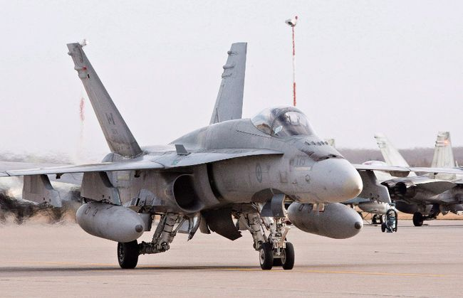 A pilot positions a CF-18 Hornet at the CFB Cold Lake, in Cold Lake, Alberta on Tuesday, October 21, 2014. The Canadian Forces says a CF-18 fighter jet has crashed in northeastern Alberta.A military spokesman said the plane was based out of Canadian Forces Base Cold Lake. (THE CANADIAN PRESS/Jason Franson)