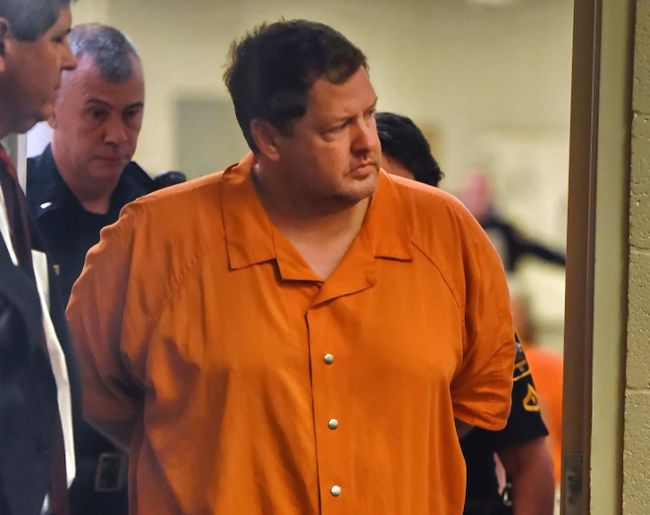 In this Sunday, Nov. 6, 2016, file photo, Todd Kohlhepp's enters the courtroom of Judge Jimmy Henson for a bond hearing at the Spartanburg Detention Facility in Spartanburg, S.C. Deputies have formally charged Kohlhepp, suspected of being a serial killer, with three additional counts of murder for bodies found buried on his land. (AP Photo/Richard Shiro, File)