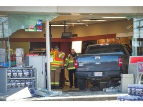 Two trapped employees had multiple injuries, including broken legs, and needed surgery and extensive treatment after  this F-150 pickup was driven by Steven Cloutier through the front of a convenience store at the PetroCanada on 97 Street and 118 Avenue on Nov. 18, 2015, court heard Monday.