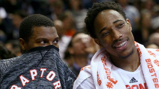 Kyle Lowry and DeMar DeRozan of the Toronto Raptors joke around on the bench against the Philadelphia 76ers during NBA Action at the Air Canada Centre in Toronto, Ont. on Monday November 28, 2016. (Dave Abel/Toronto Sun/Postmedia Network)