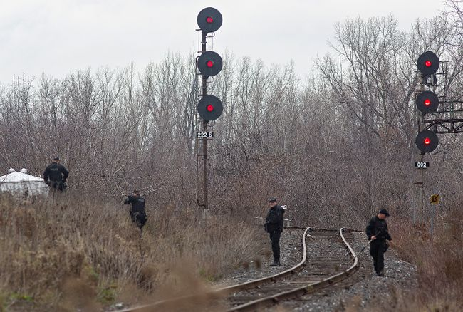 A team of Brantford police officers conducts a search along the CN tracks between Grey and Henry streets. Police are in the midst of a homicide investigation into the death of Jeffrey James Roberts, whose body was found Nov. 21, near Highway 403 and West Street.  (Brian Thompson/The Expositor)