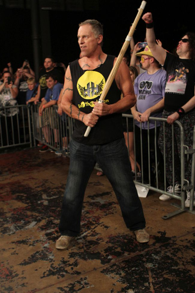 Wrestling legend Sandman, with his trademark Singapore cane, ringside at a House of Hardcore show. (George Tahinos/SLAM! Wrestling)