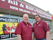 Phil Davis, left, and Bill Robbins, outside Phil and Bill's Video Emporium. Declining revenue and increasing costs have forced these former Blockbuster Video managers to close their five-year-old store. (Scott Dunn/ The Sun Times)