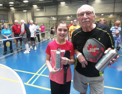KEVIN RUSHWORTH HIGH RIVER TIMES/POSTMEDIA NETWORK. Brinley Burndred, 11, and Bob Bechard, 75, took part in the recent Dinkers Unite pickleball tournament at the Cargill Fieldhouse.