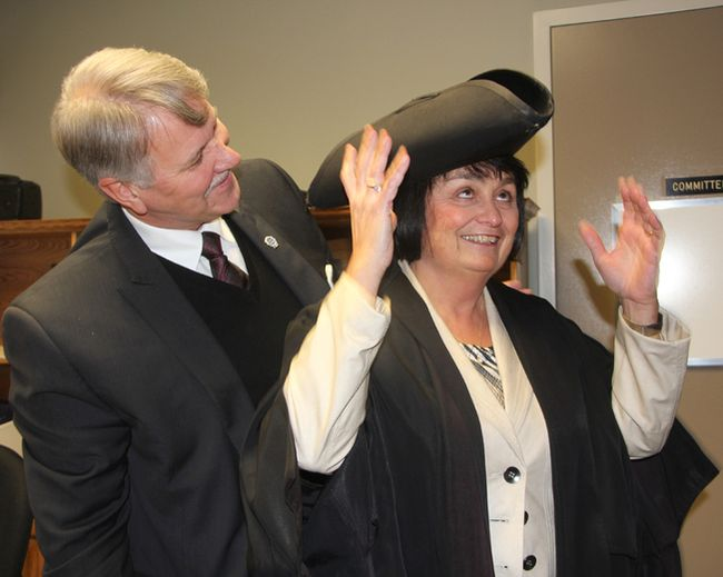 Lambton County Warden Bev MacDougall tries on the warden's traditional tricorn hat for the first time with help from St. Clair Township Mayor Steve Arnold, in this file photo. (Sarnia Observer)