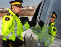 Supt. Howard Eaton speaks to a motorist. Sheriffs and RCMP conducted a checkstop near Edmonton in this file photo. The police were trying to raise awareness of drinking and driving during the holiday season. Perry Mah/Postmedia Network