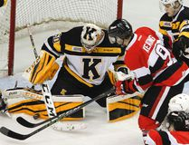 Kingston Frontenacs goalie Jeremy Helvig makes a save on Austen Keating of the Ottawa 67's during first-period OHL action at the Rogers K-Rock Centre on Wednesday night. Kingston won 2-1 in overtime. (Julia McKay/The Whig-Standard)
