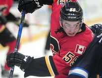Calgary Flames' Dillon Dube (59) in action against the Winnipeg Jets during second period 2016 NHL Young Stars Classic action at the South Okanagan Events Centre in Penticton, BC., September 16, 2016.