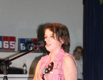 One of the performers at the Maude Burke Talent Show played the ukulele and sang.