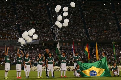 Children release balloons during a tribute to members of Brazil's Chapecoense soccer team who died in a plane crash, at Atanasio Girardot stadium where they were to play a game in Medellin, Colombia, Wednesday, Nov. 30, 2016.  (AP Photo/Fernando Vergara)