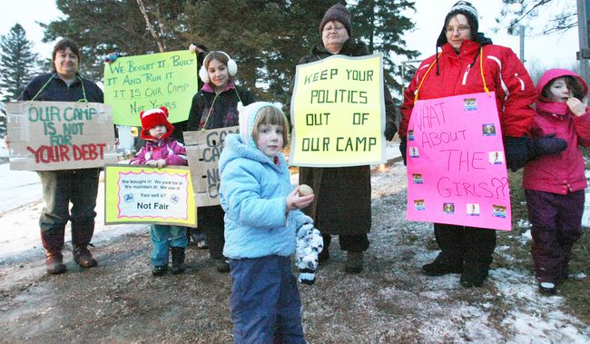 Local guides and supporters hold signs outside Camp Caritou  in 2011 protesting the sale of their camp by the Girl Guides of Canada Ontario Council. Nugget File Photo