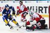 Davos' Gregory Sciaroni scores against Team Canada's Jeff Glass during a game at the 89th Spengler Cup hockey tournament in Davos, Switzerland on Dec. 30, 2015. (THE CANADIAN PRESS/AP-Gian Ehrenzeller/Keystone via AP)
