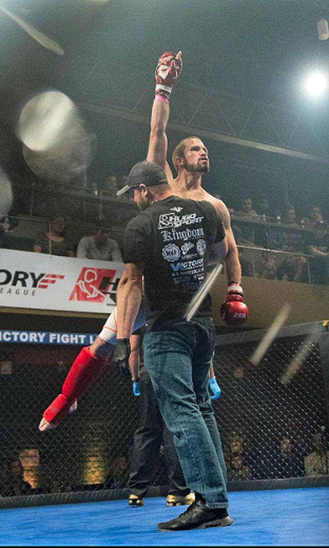 Joel Brazeau is lifted into the air after making some Victory MMA history, with the fastest knockout.