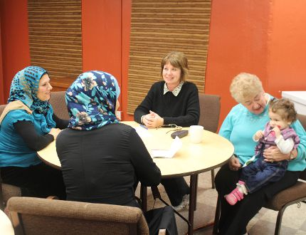 Volunteers from Huron Park Baptist Church practice English with newcomers - of all ages - at the Canadian Cultural Café on Wednesday, Nov. 30, 2016. (MEGAN STACEY/Sentinel-Review)