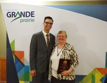 City of Grande Prairie Mayor Bill Given stands next to Patricia Cooke after giving her the George Repka Outstanding Achievement Award during a volunteer appreciation dinner at the Holiday Inn on Wednesday November 30, 2016 in Grande Prairie, Alta. Svjetlana Mlinarevic/Grande Prairie Daily Herald-Tribune/Postmedia Network