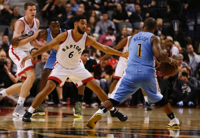 Raptors' Cory Joseph (6) guards Nuggets' Jameer Nelson (1) during first half NBA action in Toronto on Oct. 31, 2016. (Jack Boland/Toronto Sun)