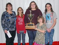 The Best Entry from a Business in the 2016 Santa Claus Parade of Lights went to Rhino Werx Renovation and Property Management. In front, Brooke Storing holds the trophy, while standing behind her are, from left to right, Samantha Matteau, Tiffany Henrie, Bailey Matteau and Jacob Matteau.
