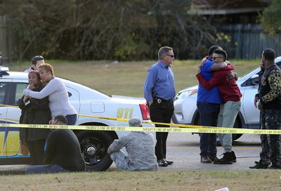 Friends and family of former NFL player Joe McKnight gather at the scene of his shooting death as the Jefferson Parish Sheriff's Office investigates in Terrytown, La., Thursday, Dec. 1, 2016. (Michael DeMocker/NOLA.com The Times-Picayune via AP)