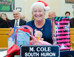 South Huron mayor Maureen Cole shows off the doll she got during the mock gift exchanged. (Darryl Coote/The Goderich Signal Star)