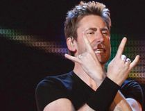 Alberta native Chad Kroeger lead vocalist and guitarist for Nickelback salutes the fans at Rexall Place on March 13, 2015. (Tom Braid/Edmonton Sun/Postmedia Network)