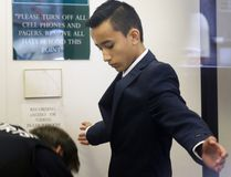 In this April 2, 2014 file photo, Justin Casquejo passes through security at a courthouse in New York. (AP Photo/Seth Wenig, File)