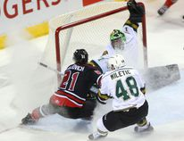 Jonah Gadjovich of the Owen Sound Attack and Sam Miletic of the Knights shower London goalie Tyler Parsons with snow as they fight for a rebound during the first period of their OHL game at Budweiser Gardens on Friday night. For the second time in nine days, the Attack won in a shootout. (MIKE HENSEN, The London Free Press)
