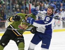 Darian Pilon, right, of the Sudbury Wolves, and Riley Bruce, of the North Bay Battalion, scuffle during OHL action at the Sudbury Community Arena in Sudbury, Ont. on Friday December 2, 2016. John Lappa/Sudbury Star/Postmedia Network