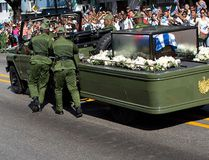Soldiers push the jeep and trailer carrying the ashes of the late Fidel Castro after the jeep briefly stopped working during Castro's funeral procession near Moncada Fort in Santiago, Cuba, Saturday, Dec. 3, 2016. (AP Photo/Rodrigo Abd)