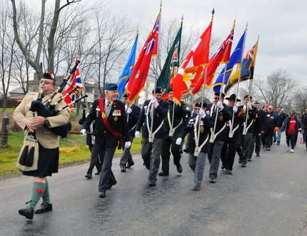 Piper Jim Yates of Townsend led a procession down Road 4 south of Fisherville on Sunday afternoon to the family home of Thomas McQueen for a solemn ceremony. McQueen died last week in a jet fighter crash in Cold Lake, Alberta. DANIEL R. PEARCE/SIMCOE REFORMER
