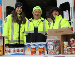 MIKE VERDONE/Sault Star Off-duty Sault Ste. Marie paramedics (from left) Anne-Marie Gerwlivch, Brian Haines and Katheryn Bobbie held a Helping the Hungry Food Drive on Saturday at Walmart on Great Northern Road, where they accepted non-perishable food items and cash donations in support of the Soup Kitchen Community Centre on James Street.