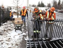 Jason Miller/The Intelligencer Crews from Quinte Fencing install fencing along Dundas Street West. With winter weather arriving in the region construction projects are wrapping up until the spring arrives.