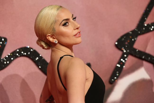 US singer Lady Gaga poses for pictures on the red carpet upon arrival to attend the British Fashion Awards 2016 in London on December 5, 2016. / AFP PHOTO / Daniel LEAL-OLIVASDANIEL LEAL-OLIVAS/AFP/Getty Images