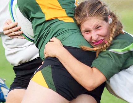 Bailey Meraw, shown making a tackle during the recent OCAA women's rugby season, is the 2016 Belleville Junior Bulldogs U18 girls MVP (backs) plus OCAA women's Rookie of the Year with the Ottawa Algonquin Thunder. (OCAA photo)