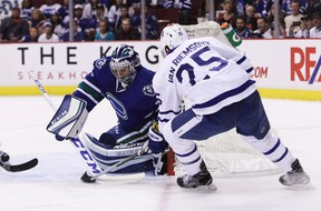 Vancouver Canucks goaltender Ryan Miller (20) makes a save against Toronto Maple Leafs' James van Riemsdyk (25) during first period NHL hockey action, in Vancouver on Saturday, December 3, 2016. THE CANADIAN PRESS/Ben Nelms