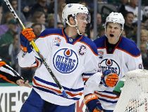 Edmonton Oilers center Connor McDavid (97) and Jesse Puljujarvi (98) of Sweden celebrate a goal by McDavid in the second period of an NHL hockey game against the Dallas Stars on Saturday, Nov. 19, 2016, in Dallas. The score was McDavid's second of the gam