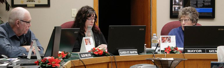 Mayerthorpe Town Council discussed a report delivered by Chief Administrative Officer Karen St. Martin (left) about the library's finances during the Nov. 28 council meeting. Kate Patrick, mayor of Mayerthorpe, (right) said the town will seek clarification from the library board about several aspects of their budget (Joseph Quigley | Mayerthorpe Freelancer).