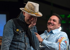 Assembly of First Nations Chief Perry Bellegarde holds an emotional Gord Downie as he is given an aboriginal name during a ceremony honouring Downie at the AFN Special Chiefs assembly in Gatineau, Que., on Tuesday. (Adrian Wyld/The Canadian Press)